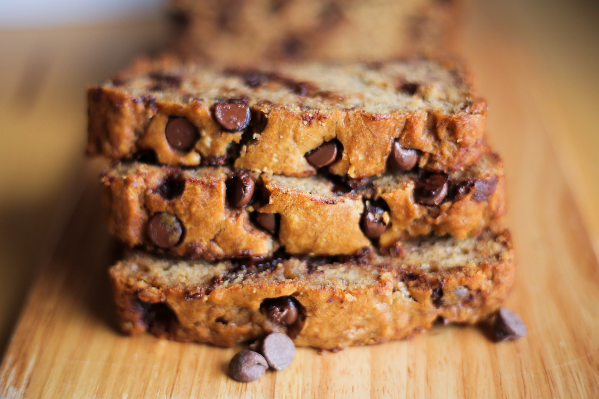 chocolate chip banana bread on a wooden board
