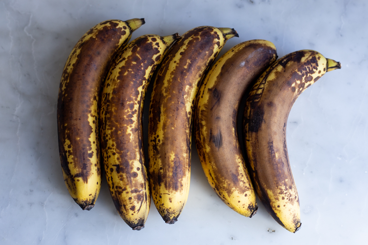 overripe bananas on a marble counter