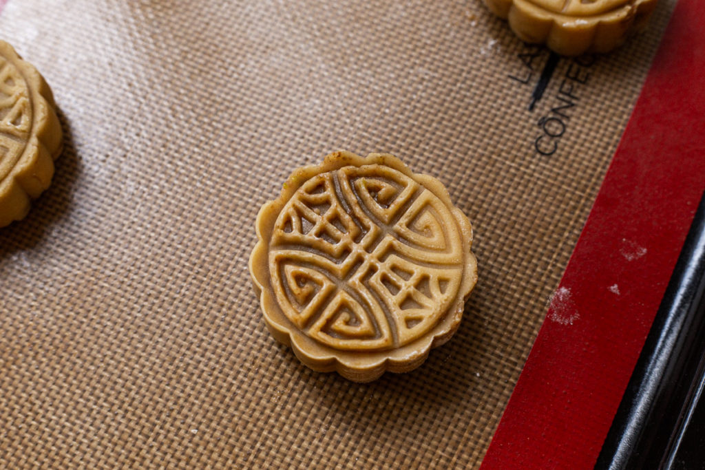 circular Maple Nut Mooncake pre-bake