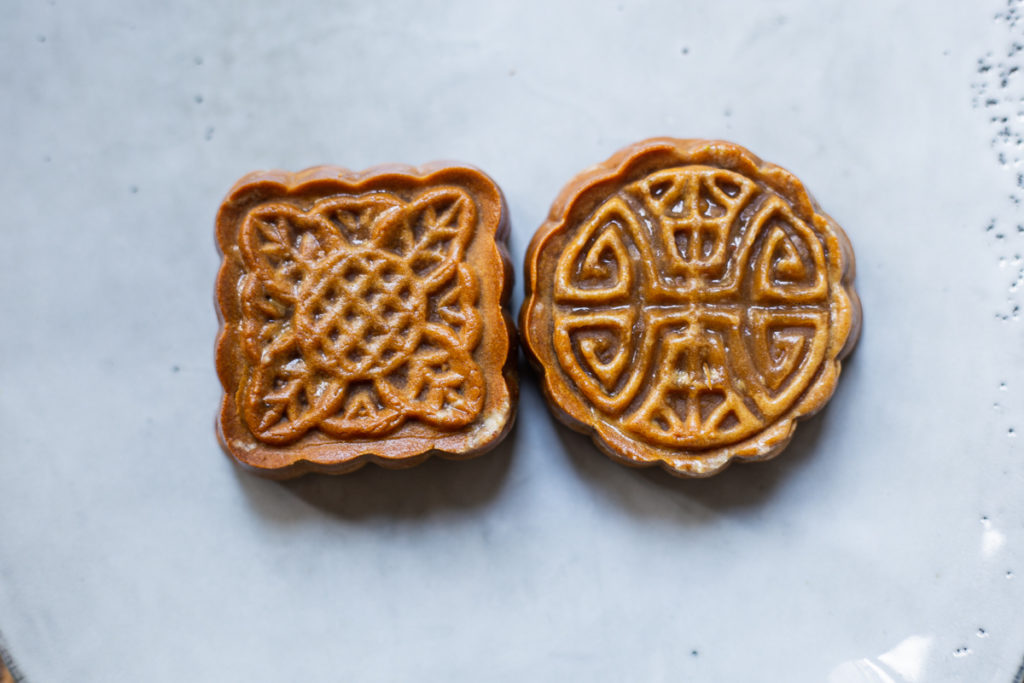 square and circle Maple Nut Mooncake on a blue plate